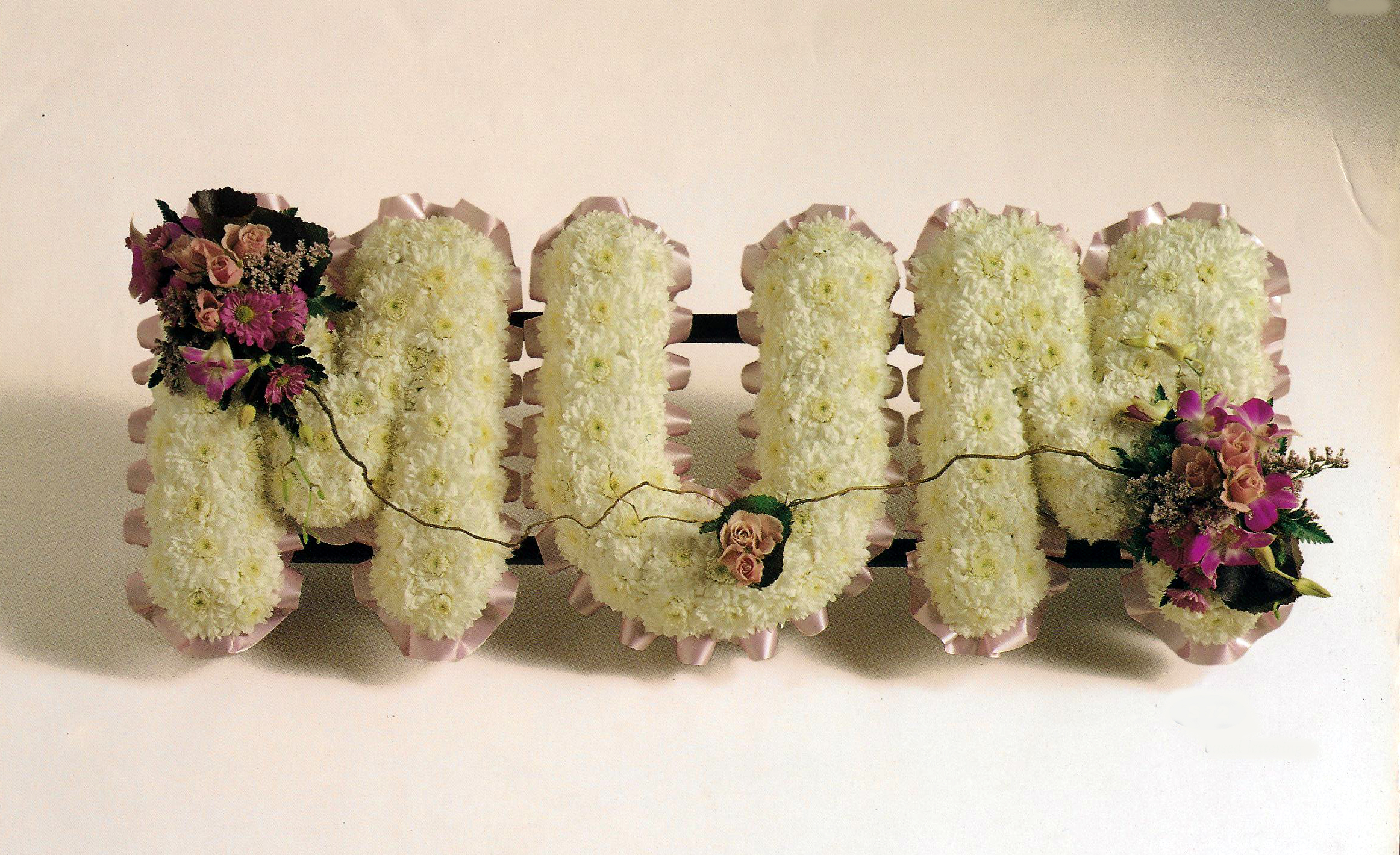 Funeral Floral Lettering £30 a letter A73. Ribbon and corsage colour to your choice.