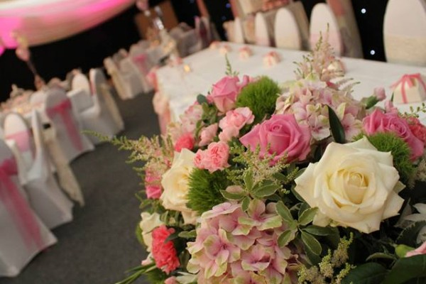 Pink, cream and green top table arrangement